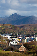 """The town of Clifden, in Connemara, Co. Galway, the """"capital of Connemara"""". It's a market town founded in the early 19th century by John D'Arcy. The Twelve Bens, or Pins mountains are in the background."""