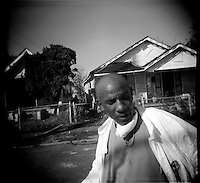 Mingko Aba takes a moment outside after going through his house in the upper 9th ward for the first time since Hurricane Katrina, which made land fall over a month ago  5 October 2005 New Orleans Louisiana.     photo by Darren Hauck