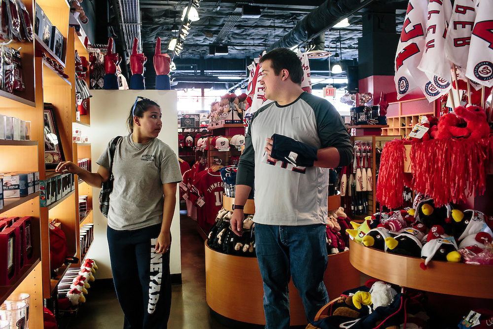Jamie Guzman, left, and her fiancee Shaun Hampton, look for new items to celebrate the Washington Nationals making the playoffs at the Washington Nationals Clubhouse Team Store on Sept. 18, 2014. The Nationals and Baltimore Orioles clinched the first two post season spots within hours of one another.