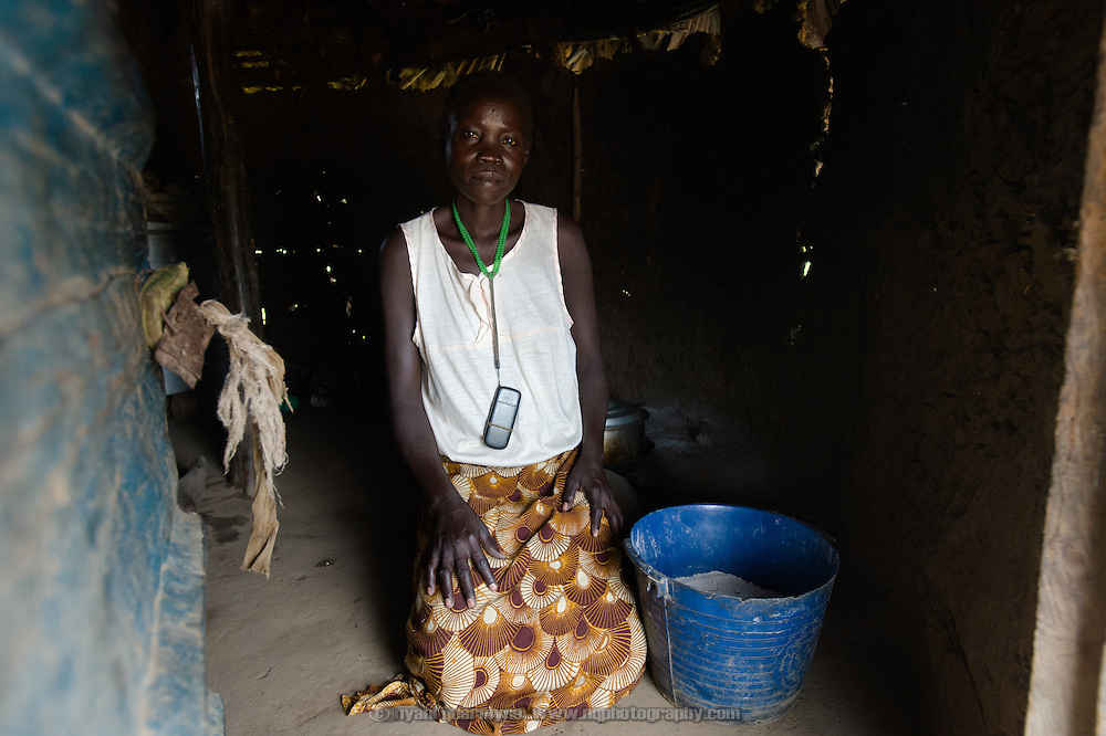 Rose Oliver, pictured on 8 August 2014, says she fled fighting in Juba in December 2013, and moved to the village of Kudo in Eastern Equatoria where she has relatives. She relates that, &ldquo;There was a little bit of food, and we ate it all, and we had to buy from the market with money. We would buy just one bowl [of sorghum] and it's SSP 7.00. We would make small portions and it would last us seven days. Of course it's not enough, but we would drink water and it will fill the stomach.&rdquo; She buys sugar on credit and uses it to brew alcohol which she sells to earn an income: &ldquo;I don't have any other job, so where else can I get money?&rdquo; Rose is illiterate, saying, &ldquo;I didn't learn to write because I got married very early, at around 12. I got pregnant, so we went together [she and her husband] to Khartoum.&rdquo; She relates that her husband was much older; she was his third wife. He has since passed away.<br /> <br /> Due to a combination of drought in some parts of the country, the ravages of pests in others, and instability caused by war, many South Sudanese are facing acute food shortages and possibly famine.