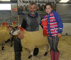 Tom Heneghan with grand daughter Ailish won 1st prize for Greyface Hoggets at the Mayo Mule and Greyface Show in Ballinrobe on friday last sponsored by Cormac Tagging.<br /> Pic Conor McKeown