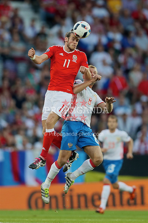 TOULOUSE, FRANCE - Monday, June 20, 2016: Wales' Gareth Bale in action against Russia's Denis Glushakov during the final Group B UEFA Euro 2016 Championship match at Stadium de Toulouse. (Pic by David Rawcliffe/Propaganda)