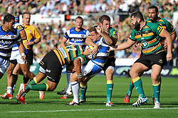 George Ford of Bath Rugby is tackled by Luther Burrell and Stephen Myler of Northampton Saints - Photo mandatory by-line: Patrick Khachfe/JMP - Mobile: 07966 386802 27/09/2014 - SPORT - RUGBY UNION - Northampton - Franklin's Gardens - Northampton Saints v Bath Rugby - Aviva Premiership