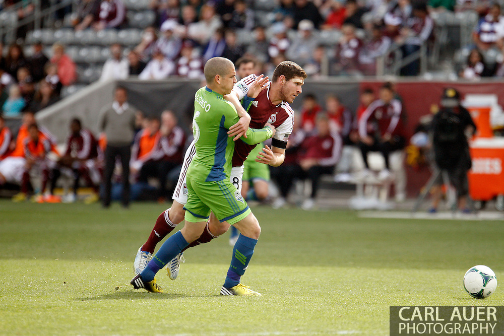 April 20th, 2013 Commerce City, CO - Colorado Rapids midfielder Dillon Powers (8) attempts to get past Seattle Sounders FC midfielder Osvaldo Alonso (6) in first half action of the MLS match between the Seattle Sounders FC and the Colorado Rapids at Dick's Sporting Goods Park in Commerce City, CO