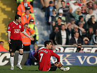Photo: Lee Earle.<br /> Portsmouth v Manchester United. The Barclays Premiership. 07/04/2007.United's Wayne Rooney (L) and Cristiano Ronaldo look dejected as they trail to Portsmouth.