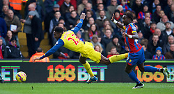 LONDON, ENGLAND - Saturday, February 21, 2015: Arsenal's Danny Welbeck is brought down by Crystal Palace's Fraizer Campbell for a penalty during the Premier League match at Selhurst Park. (Pic by David Rawcliffe/Propaganda)