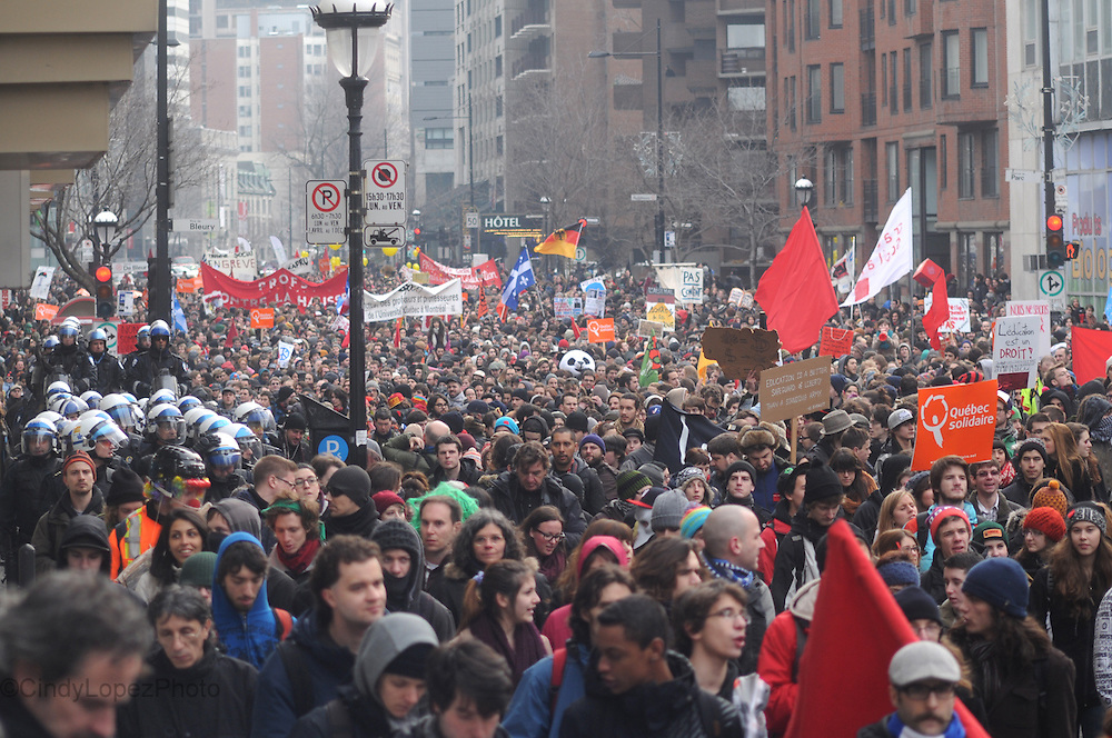 Thousands of students and supporters marched on Sherbrooke St protesting the student tuition hike after the Quebec education summit in Montreal. February 2013. (Cult MTL)