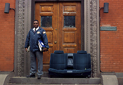 security guard student stands next to car seats at University of PA fraternity house steps