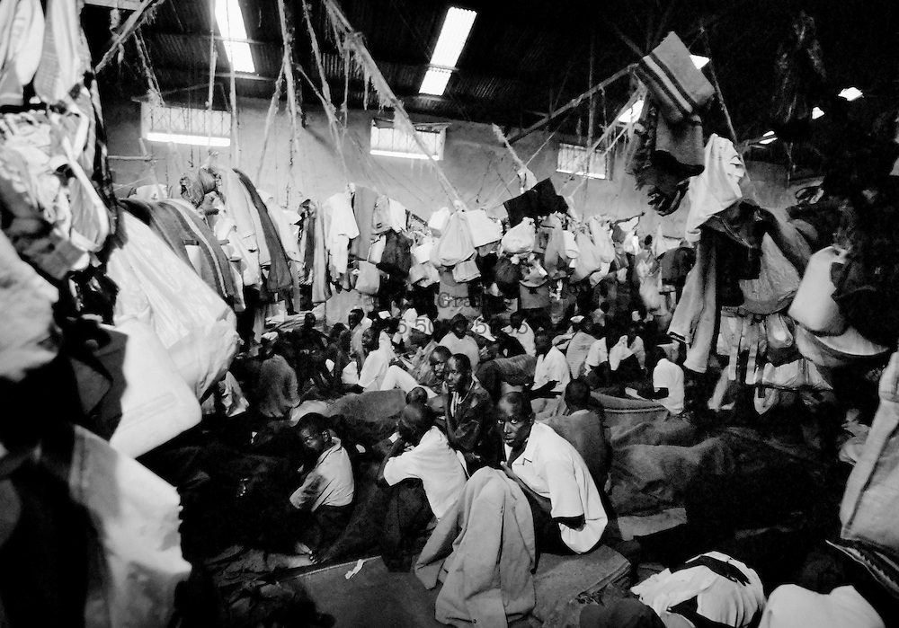 After the genocide, the Tutsis launched a violent hunt for the Hutus behind the killings. Rwanda's government created temporary jails to house the several hundred thousand suspects, who waited – and are still waiting – to be tried. Some of them were packed into an abandoned coffee factory in Kigali. April 1994.