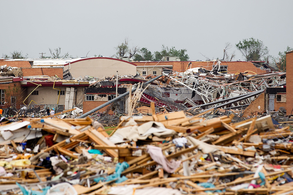 May 24, 2011- The remains of Joplin High School in Joplin, Missouri rises above debris of homes after a Tornado came through the town on Sunday, May 22, 2011. Credit: David Welker / TurfImages.com