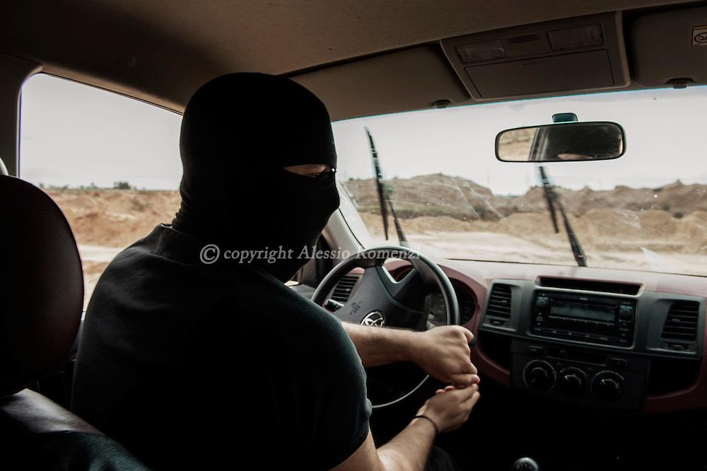 Libya, Zuwara: Members of the Black Masks volunteer special forces are seen in the city of Zuwara. Alessio Romenzi