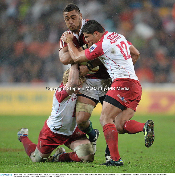 8 June 2013; Toby Faletau, British & Irish Lions, is tackled by Beau Robinson, left, and Anthony Faingaa, Queensland Reds. British & Irish Lions Tour 2013, Queensland Reds v British & Irish Lions, Suncorp Stadium, Brisbane, Queensland, Australia. Picture credit: Stephen McCarthy / SPORTSFILE