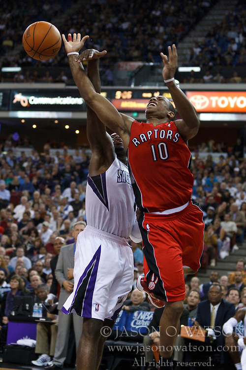 November 1, 2010; Sacramento, CA, USA;  Toronto Raptors shooting guard DeMar DeRozan (10) is defended by Sacramento Kings point guard Tyreke Evans (13) during the fourth quarter at the ARCO Arena. The Kings defeated the Raptors 111-108.