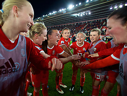 SOUTHAMPTON, ENGLAND - Friday, April 6, 2018: Wales players celebrate after a hard fought goal-less draw against England during the FIFA Women's World Cup 2019 Qualifying Round Group 1 match between England and Wales at St. Mary's Stadium. Rhiannon Roberts, Natasha Harding, Kayleigh Green, Charlie Estcourt, Hannah Miles. (Pic by David Rawcliffe/Propaganda)