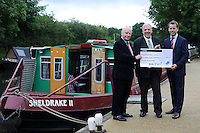 Gerald Corbett, Britvic Chairman, Ron Overton, ReachOut Plus Director and Jonathan Aves Foundation Director, Hertfordshire Community Foundation. ReachOut Plus receive a cheque for £2,500 at The Boat Base is in Red Lion Lane, Nash Mills, Hemel Hempstead