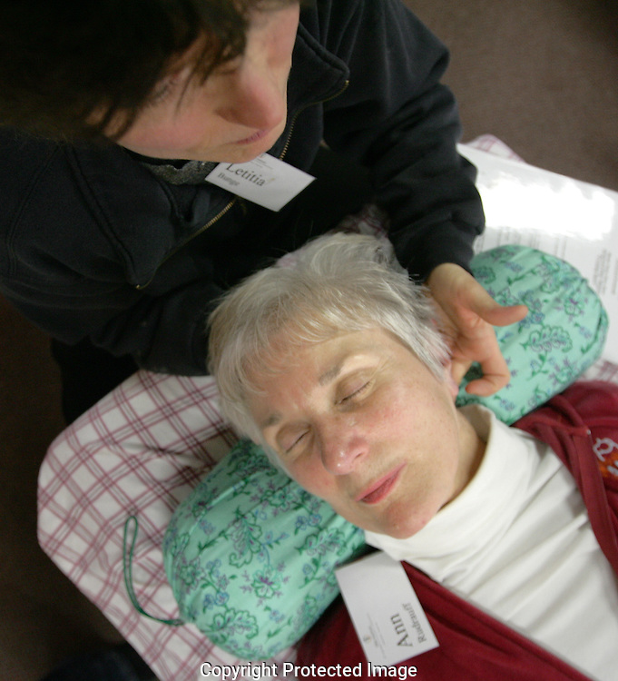 Letitia Bunge applies polarity therapy to Ann Rudrauff during a Saturday class at the Columbus Polarity Center.(Jodi Miller/Alive)..Columbus Polarity Center 1253 N High St.