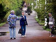 Pensioners feeding birds at the spa resort of Frantiskovy Lazne in Czech Republic.