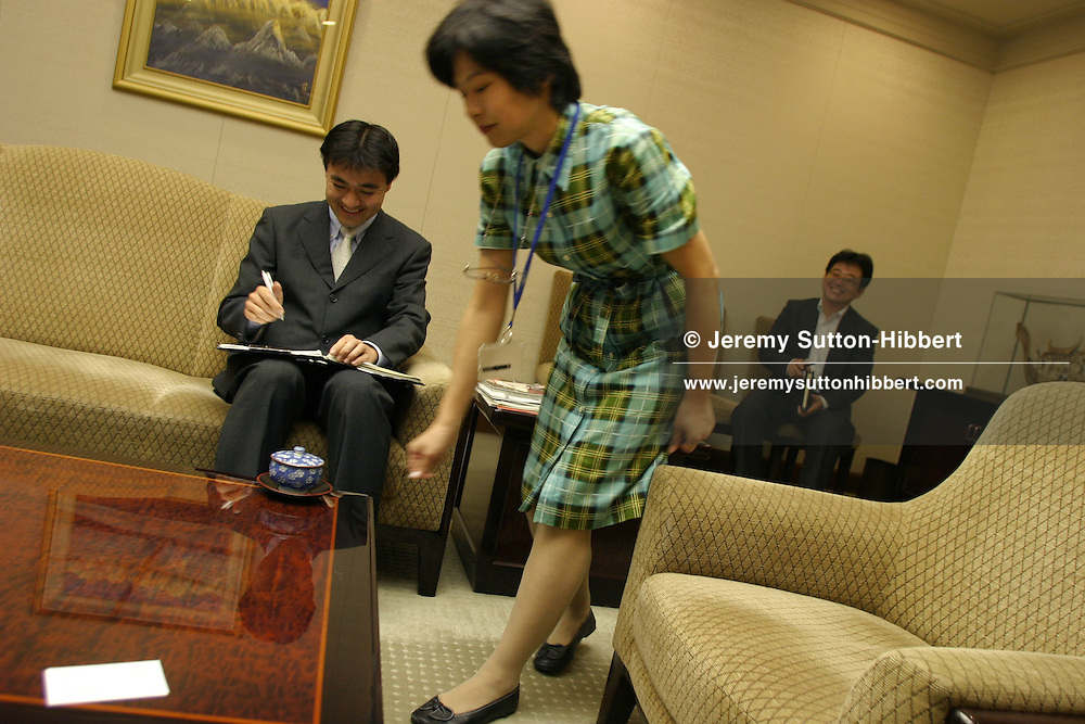 Tea being brought for guests during a meeting with Taizo Nishimuro, President and CEO of Tokyo Stock Exchange, in an interview, Monday, June 26th 2006, in Tokyo, Japan,