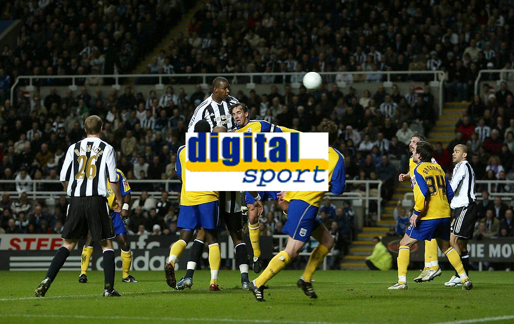 Photo: Andrew Unwin.<br />Newcastle United v Southampton. The FA Cup. 18/02/2006.<br />Newcastle's Titus Bramble (C) rises highest but puts his header wide of the goal.