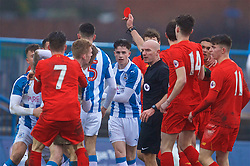 ASHTON-UNDER-LYNE, ENGLAND - Sunday, February 12, 2017: Huddersfield Town's Jamie Spence is shown a red card by referee Steven Rushton as a mêlée ensues during the FA Premier League Cup Group G match against Liverpool at Tameside Stadium. (Pic by David Rawcliffe/Propaganda)