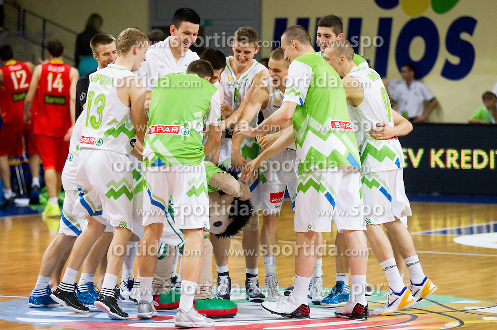 Players of Slovenia celebrate after the basketball match between National teams of Slovenia and Spain in Qualifying Round of U20 Men European Championship Slovenia 2012, on July 18, 2012 in Domzale, Slovenia. Slovenia defeated Spain 70-63. (Photo by Vid Ponikvar / Sportida.com)