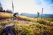 Woman riding MTB mountainbike in European mountains