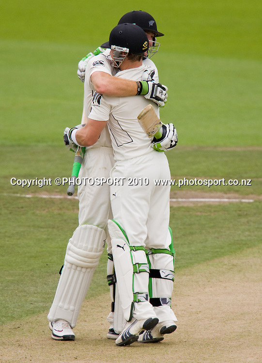 Brendon McCullum hugs fellow century maker Martin Guptill after making his 100 during his century during day 2 of the one off test cricket match between New Zealand Black Caps and Bangladesh at Seddon Park, Hamilton, New Zealand, Tuesday 16 February 2010. Photo: Stephen Barker/PHOTOSPORT