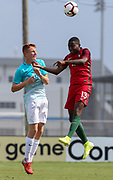 Portugal forward Dario Essugo (13) and Slovenia midfielder Enej Marsetic (9) go up for a header during a CONCACAF boys under-15 championship soccer game, Sunday, August 11, 2019, in Bradenton, Fla. Portugal defeated Slovenia in the final in 2-0. (Kim Hukari/Image of Sport)