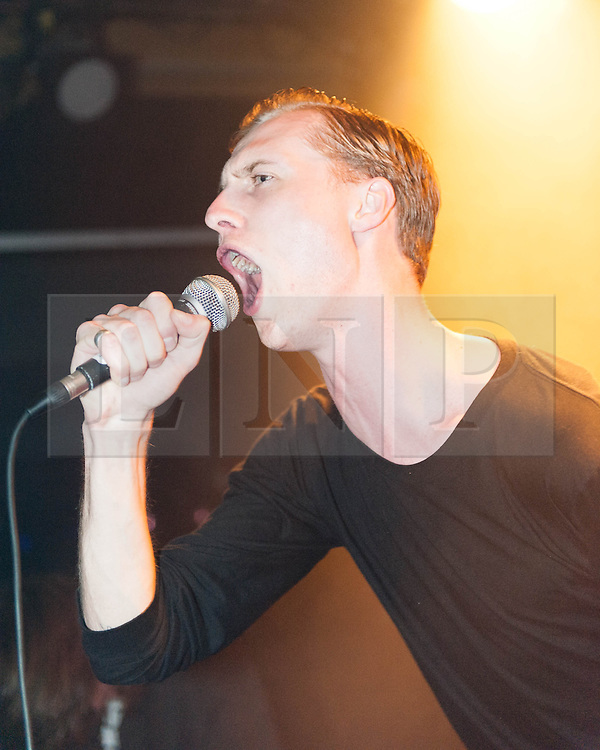 © Licensed to London News Pictures. 04/04/2014. Rotterdam, Netherlands.   Eagulls performing live at Motel Mozaique Festival.  In this picture - George Mitchell.  Eagulls are an English post-punk band from Leeds, England, consisting of Mark Goldsworthy (guitar), Henry Ruddel (drums), Liam Matthews (guitar), Tom Kelly (bass), and George Mitchell (vocals).  Eagulls performed on the american tv show Letterman in January and have been receiving excellent reviews for their eponymous debut album.  Motel Mozaïque is an annual music/arts festival, held annually in Rotterdam, Netherlands.  Photo credit : Richard Isaac/LNP