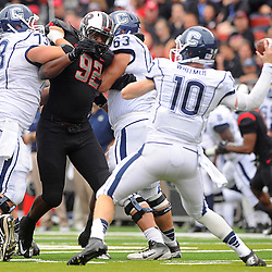 Oct 6, 2012: Rutgers Scarlet Knights defensive lineman Jamil Merrell (92) tries to break past Connecticut Huskies guard Alex Mateas (73) and offensive tackle Adam Masters (63) to put pressure on quarterback Chandler Whitmer (10) during second half NCAA college football action between the Rutgers Scarlet Knights and UConn Huskies at High Point Solutions Stadium in Piscataway, N.J.
