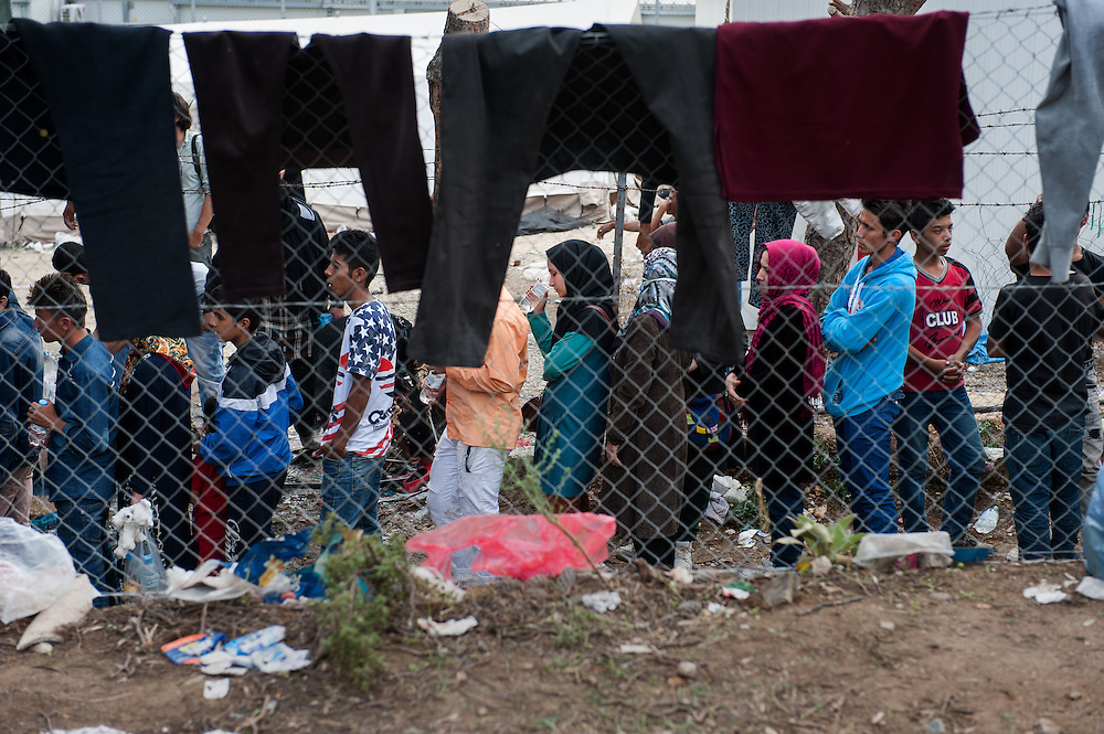 Refugees and migrants queuing to get registered outside Moria camp, Lesvos, Greece.