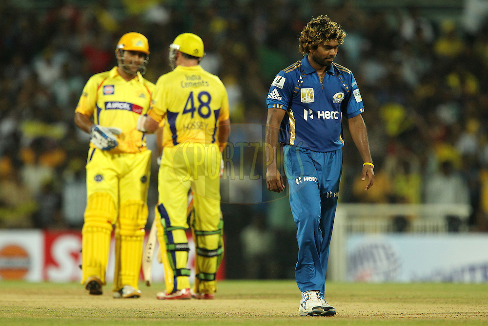 Lasith Malinga reacts as Michael Hussey and MS Dhoni chat during match 3 of the NOKIA Champions League T20 ( CLT20 )between the Chennai Superkings and the Mumbai Indians held at the M. A. Chidambaram Stadium in Chennai , Tamil Nadu, India on the 24th September 2011..Photo by Ron Gaunt/BCCI/SPORTZPICS