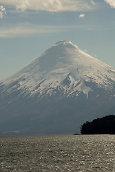 Chile, Lake Country: View of Osorno Volcano while riding across Lake Todos Los Santos..Photo #: ch631-33957..Photo copyright Lee Foster www.fostertravel.com, lee@fostertravel.com, 510-549-2202.
