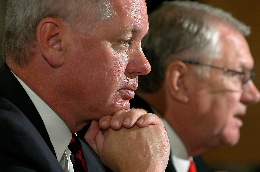 Paul Krebs, left, Vice President of Athletics at the University of New Mexico, pauses as David Schmidly, right, President of the University of New Mexico fields questions from the media during a news conference in Albuquerque, N.M. Wed. Nov. 4, 2009.  (Pat Vasquez-Cunningham/Journal)