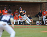 Mississippi's Zach Miller (1) throws out Virginia's Keith Werman (2) during an NCAA Regional game at Davenport Field in Charlottesville, Va. on Saturday, June 5, 2010.
