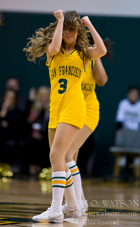 January 30, 2010; San Francisco, CA, USA;  A San Francisco Dons cheerleader performs during the second half against the Gonzaga Bulldogs at the War Memorial Gym.  San Francisco defeated Gonzaga 81-77 in overtime.