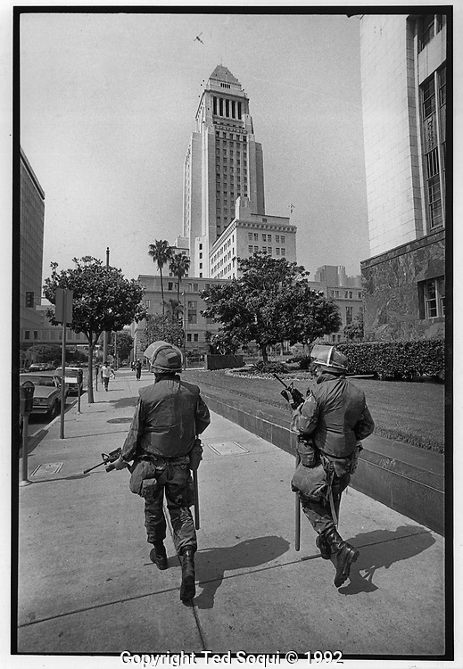 National Guard walking on patrol next to LA City Hall.