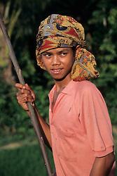 Asia, Indonesia, Sulawesi, Tana Toraja region. Boy wearing colorful scarf