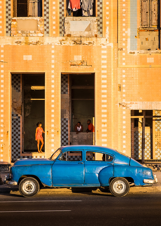 HAVANA, CUBA - CIRCA MAY 2016:  Classic American Car parked in front of an old building of the Malecon in Havana, Cuba.