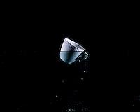 "Unfired Porcelain cup submerged in water .Art projekt, by ceramic artist Ane Fabricius Christiansen, Denmark. Coffee cup from Royal Copenhagen Porcelain Manufactory. .The porcelain is unfired and therefore dissolves back to sediment when submerged into water..The series of 23 photographs in Sediment captures the life cycle of the material using one of Royal Copenhagen Porcelain Manufactory´s  most famous designs. The porcelain cup is from the ""Half Lace"" tableware series, which has been in production since late 1800 and is emblematic of the Danish porcelain tradition. By virtue of its history and familiarity as an everyday object, it serves as a metaphor for the universal icon of the vessel..Ungebrannte Kaffeetasse aus Porzellan von Keramikkünstlerin Ane Fabricius Christiansen, Dänemark. Kaffeetasse von der Royal Copenhagen Porzellanherstellung. Das Porzellan ist nicht gebrannt und löst sich deshalb im Wasser auf. Es ist aus der ,,Half Lance""- Geschirr-Serie, die seit dem Ende des 18. Jahrhunderts produziert wird und als Inbegriff für die dänische Porzellantradition steht..© 2008 - 2010 Jesper Balleby / Agentur Focus"