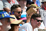 A spectator rubbing sheets of sandpaper together during the ICC Cricket World Cup 2019 match between Afghanistan and Australia at the Bristol County Ground, Bristol, United Kingdom on 1 June 2019.
