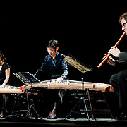 "April 9, 2011 - Manhattan, NY : From left to right, Masumi Takamizu, Mutsumi Takamizu and James Nyoraku Schlefer perform during the Japan Society's all-day special ""Concert For Japan"" charity event on Saturday. (This was taken during the Open Concert: Japanese Traditional Music set)... CREDIT: Karsten Moran for The New York Times."
