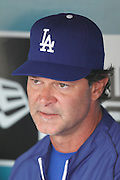 LOS ANGELES - JUNE 19:  Manager Don Mattingly #8 of the Los Angeles Dodgers talks to the media before the game against the Houston Astros at Dodger Stadium on Sunday, June 19, 2011 in Los Angeles, California.  The Dodgers defeated the Astros 1-0.  (Photo by Paul Spinelli/MLB Photos via Getty Images) *** Local Caption *** Don Mattingly