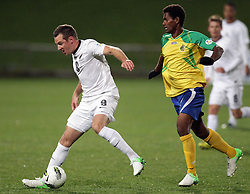 New Zealand's Shane Smeltz is chased by Solomon Islands' Hardies Aengari in a FIFA World Cup Qualifier Match, North Harbour Stadium, Auckland, New Zealand, Tuesday, September 11, 2012.  Credit:SNPA / David Rowland