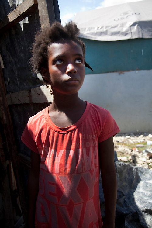 Portrait of Venise Germain, 10-year-old girl,who was raped in the last 3 months in the makeshift refugee camp, La Piste, in Port-au-Prince, Haiti on July 20, 2010. La Piste (French for &quot;runway&quot;)is a settlement sprawled across the site of a disused airport and now home to an estimated 20,000 earthquake survivors living in makeshift structures.<br /> Six month after a catastrophic earthquake measuring 7.3 on the Richter scale hit Haiti on January 13, 2010, killing an estimated 230,000 people, injuring an estimated 300,000 and making homeless an estimated 1,000,000.