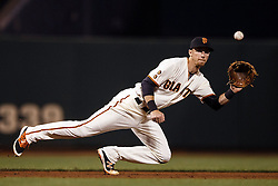 SAN FRANCISCO, CA - APRIL 20: Matt Duffy #5 of the San Francisco Giants dives for and catches a line drive hit off the bat of Chris Owings (not pictured) of the Arizona Diamondbacks during the sixth inning at AT&T Park on April 20, 2016 in San Francisco, California.  (Photo by Jason O. Watson/Getty Images) *** Local Caption *** Matt Duffy