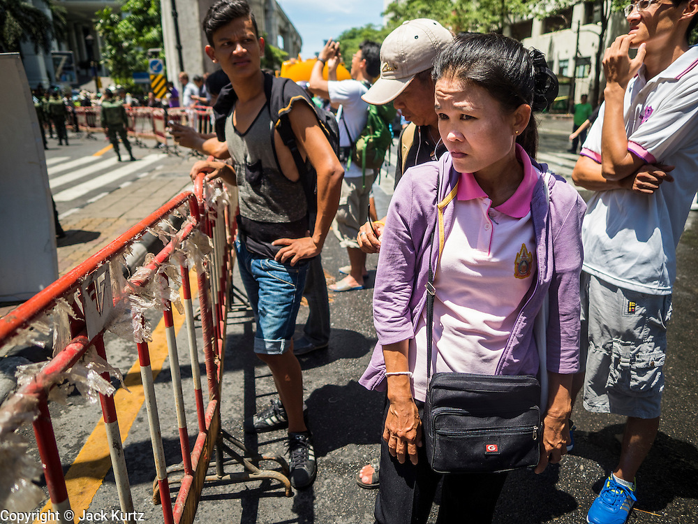 18 AUGUST 2015 - BANGKOK, THAILAND: Thai people look at the damage at the Erawan Shrine Tuesday. An explosion at Erawan Shrine, a popular tourist attraction and important religious shrine in the heart of the Bangkok shopping district, killed at least 20 people and injured more than 120 others, including foreign tourists, during the Monday evening rush hour. Twelve of the dead were killed at the scene. Thai police said an Improvised Explosive Device (IED) was detonated at 18.55. Police said the bomb was made of more than six pounds of explosives stuffed in a pipe and wrapped with white cloth. Its destructive radius was estimated at 100 meters.    PHOTO BY JACK KURTZ