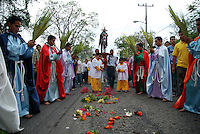 """Mexico, Oaxaca, Oaxaca de Juarez, April 17, 2011. On the Sunday before Easter, Mexico's most important holiday, two very different congregations marked the beginning of Semana Santa and the entry of Jesus into Jerusalem with prayer and processions. The Templo de la Compania de Jesus welcomed Archbishop Jose Luis Chavez Botello for the """"Blessing of the Palms"""" in central Oaxaca, while the small community of Santa Cruz de Xoxocotlan carried Jesus through rainy streets strewn with flowers."""