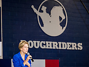 "21 OCTOBER 2019 - DES MOINES, IOWA: US Senator ELIZABETH WARREN (D-MA) talks to about 500 students during an assembly at Roosevelt High School in Des Moines. The school's athletic teams are called the ""Roughriders"" after Teddy Roosevelt's Roughriders of the Spanish-American War. Sen. Warren talked to students about her journey from childhood in Oklohoma to running for the US Presidency. Sen. Warren is campaigning to be the Democratic nominee for the US presidency in Iowa this week. Iowa traditionally hosts the the first selection event of the presidential election cycle. The Iowa Caucuses will be on Feb. 3, 2020.                 PHOTO BY JACK KURTZ"