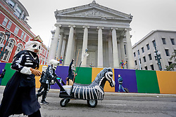 17 Feb 2015. New Orleans, Louisiana.<br /> Mardi Gras Day. Walking with Skeletons. <br /> Passing Gallier Hall. The Skeleton Krewe meets before dawn beside a cemetery in Uptown New Orleans. They then walk several miles Along Saint Charles Avenue to the French Quarter to celebrate Mardi Gras Day.<br /> Photo; Charlie Varley/varleypix.com
